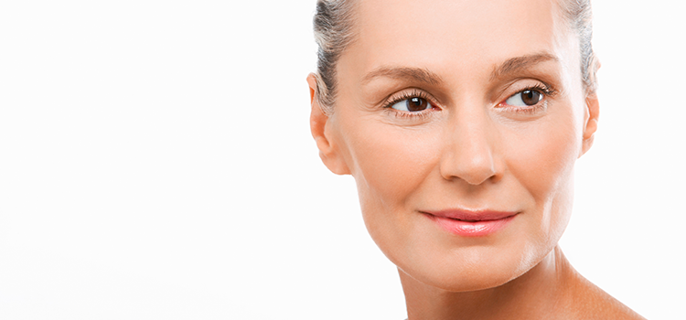 Middle aged woman with smooth skin looking right