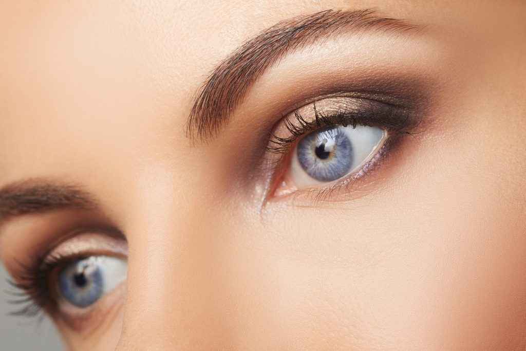 close up of young woman's blue eyes