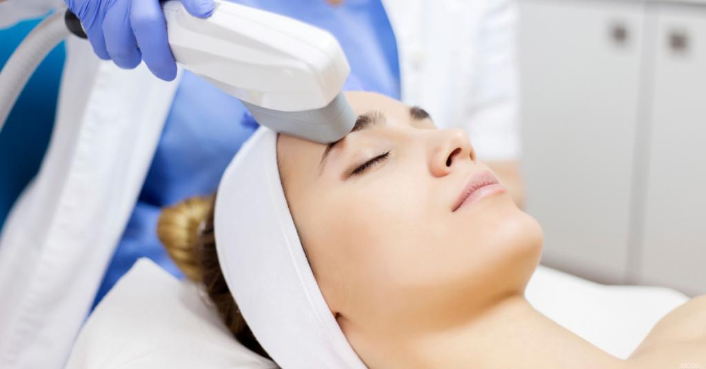 A woman receives laser skin resurfacing treatment.